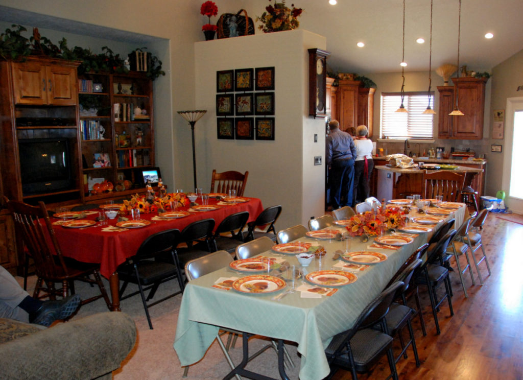 Big family Thanksgiving celebration with two tables