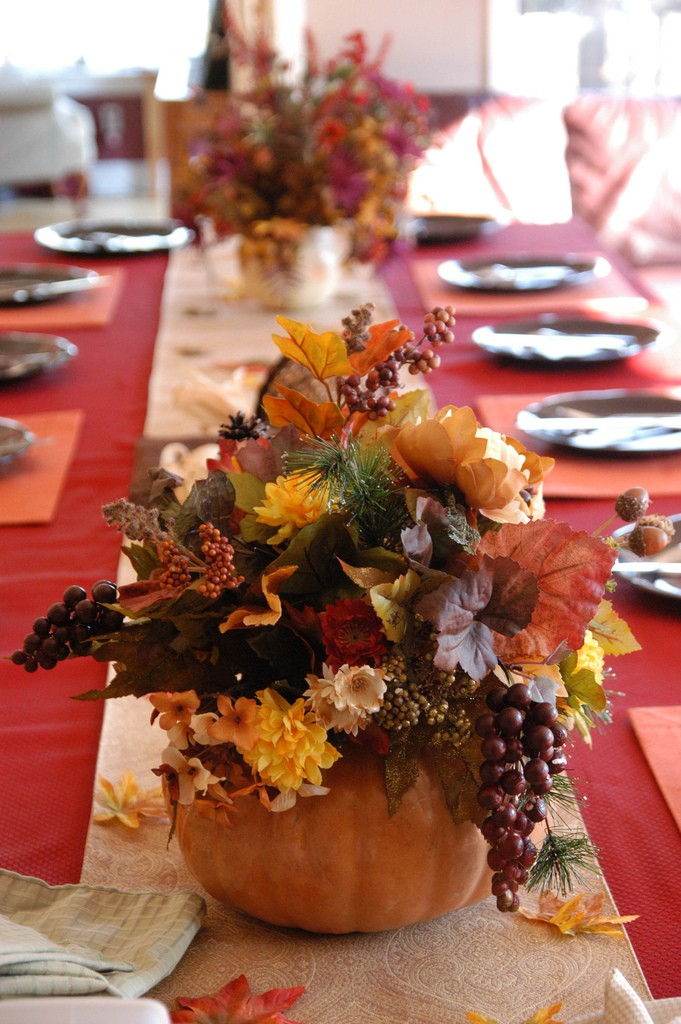 Centerpieces with flowers tucked into pumpkins