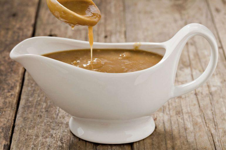 Creamy gravy in a gravy boat | Thanksgiving.com