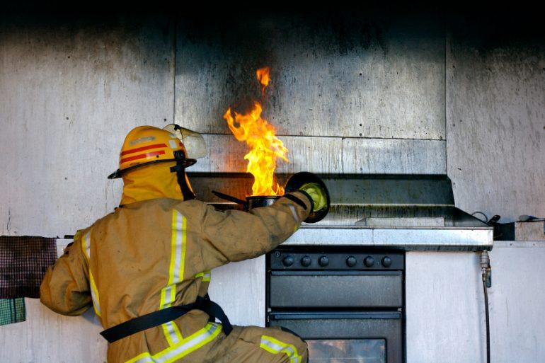 Fireman putting out a kitchen fire   Thanksgiving.com