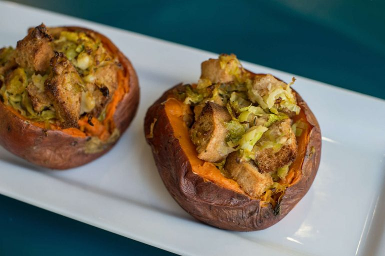 Sweet potatoes stuffed with stuffing, leeks and Brussels sprouts for a Thanksgiving side dish | Thanksgiving.com
