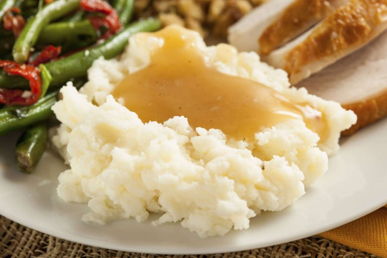 The best basic pan gravy on top of mashed potatoes   Thanksgiving.com