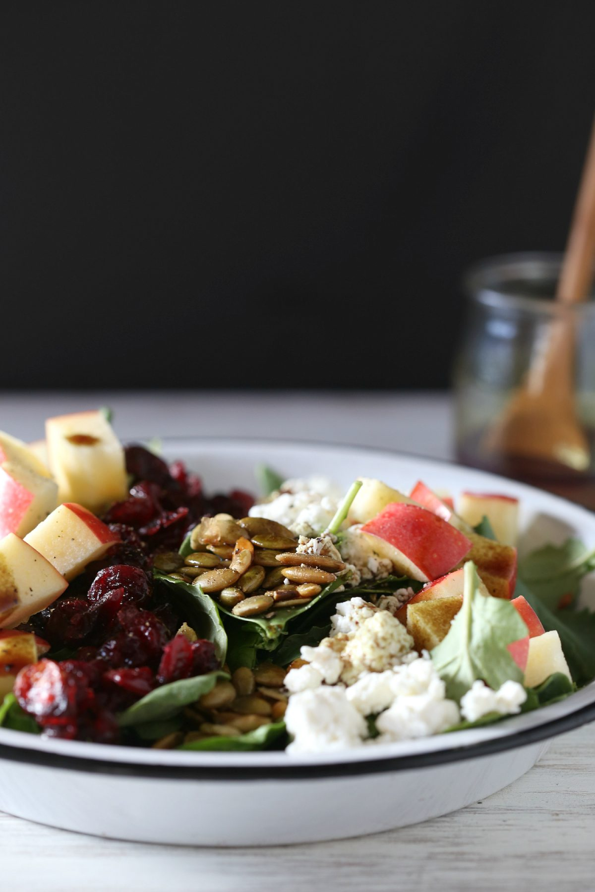 I can't wait to serve this autumn chopped kale and spinach salad with cranberries and goat cheese on Thanksgiving | Thanksgiving.com
