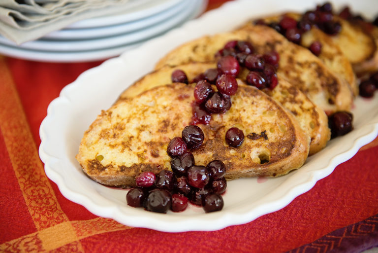 French toast with maple cranberry sauce for Thanksgiving breakfast from Thanksgiving.com. Use up those Thanksgiving leftover cranberries!