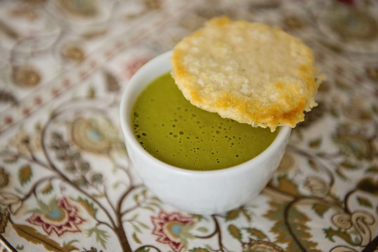 Cream of kale soup with Parmesan crisp for vegetarian Thanksgiving menu from Thanksgiving.com