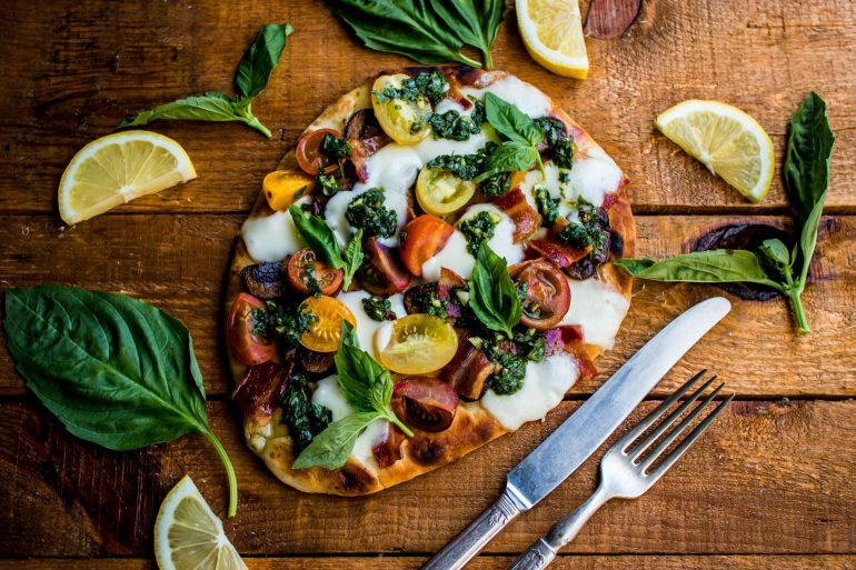 grilled naan pizza with fresh mozzarella, farmer's market veggies, and bacon