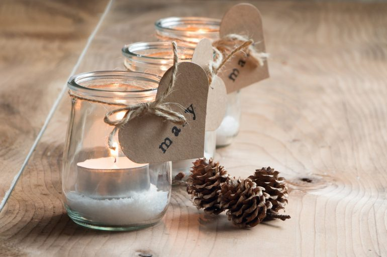 Hand-stamped place cards on candle jars