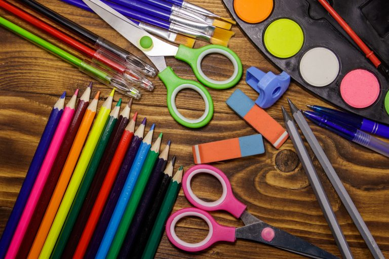 Set of school stationery supplies on wooden desk