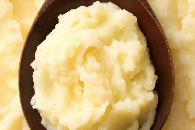 Mashed potatoes on a wooden spoon