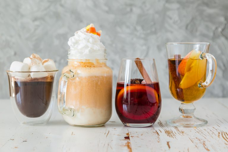 Selection of autumn drinks on wood background