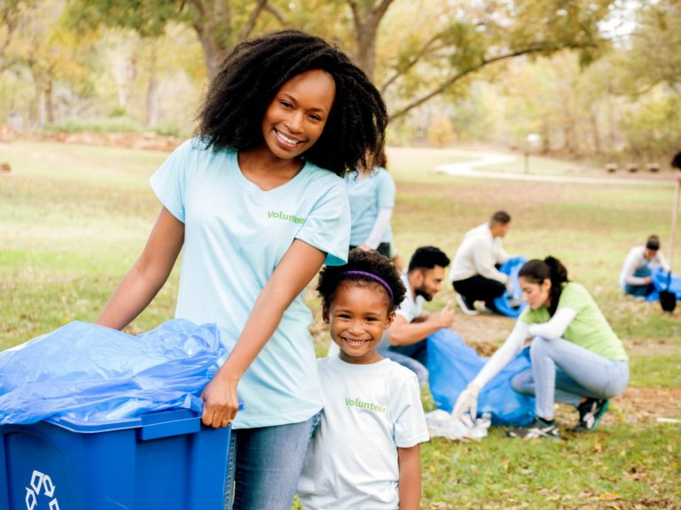 Young girl and her mom help clean up community