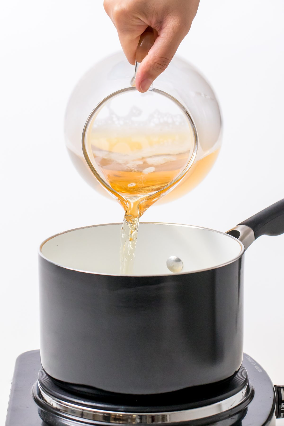 5D4B2498 - Hot Apple Cider with Buttered Rum - Combine cider, butter, fruit, ginger, spices, and brown sugar