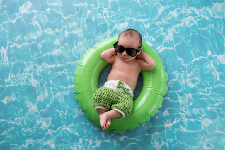 Baby floating on a green swim ring