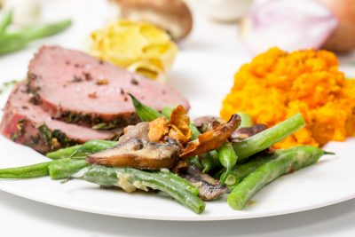 5D4B2900 - Vegan Green Bean Casserole - plated green beans with a side of ham and sweet potatoes