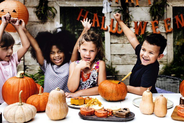 Playful kids enjoying the Halloween festival
