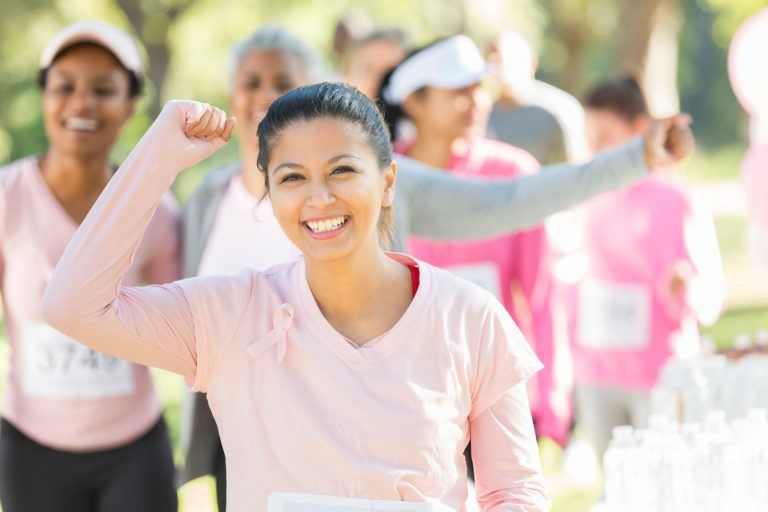 Breast cancer survivors crosses finish line during charity race