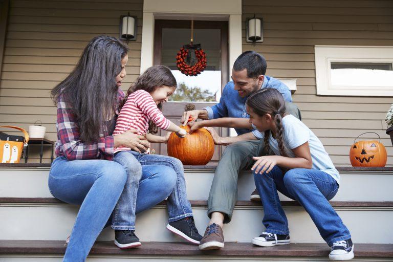 Halloween Pumpkin Designs Family Carving Halloween Pumpkin On House Steps