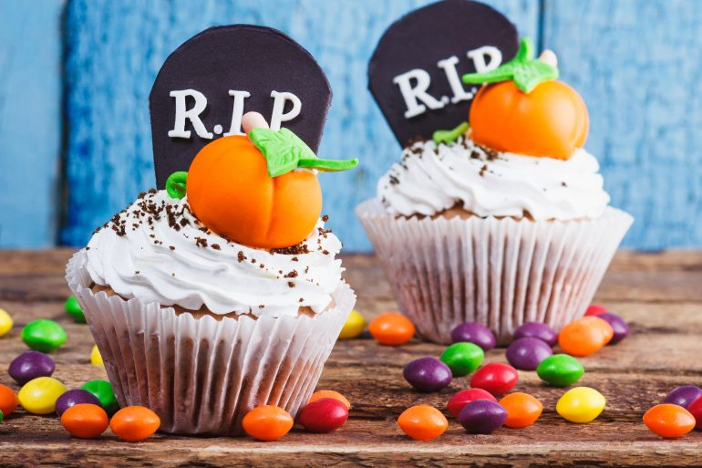 Halloween cupcakes with colored mastic decorations