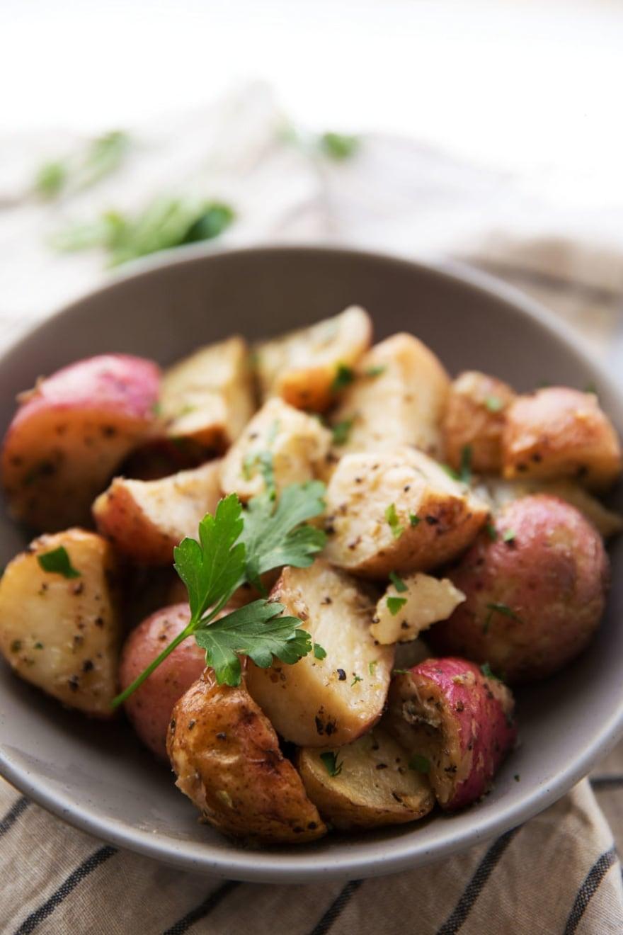 Vegan gluten-free Friendsgiving easy herb-roasted red potatoes