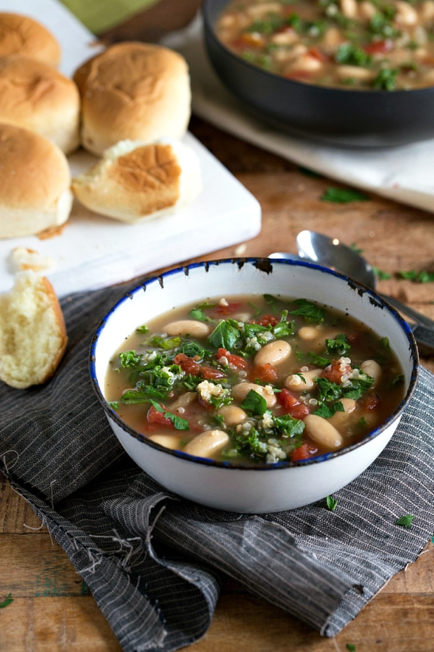 Vegan gluten-free Friendsgiving slow cooker quinoa white bean kale soup
