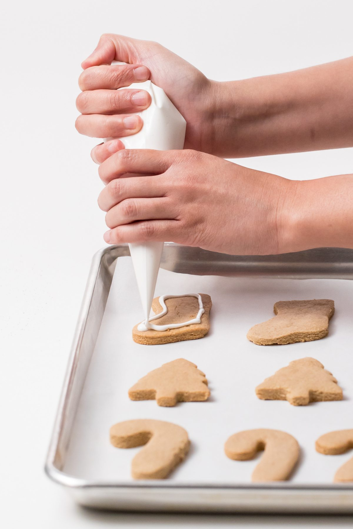 5D4B7366 - Vegan Gluten-Free Iced Holiday Shortbread Cookies - Pipe icing on the cookies