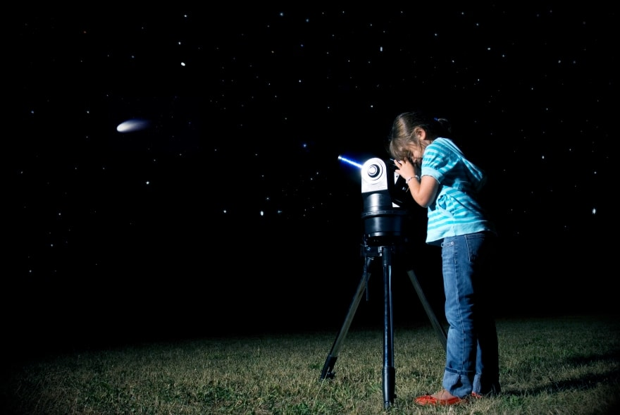 Find these constellations with your kids girl looking through telescope