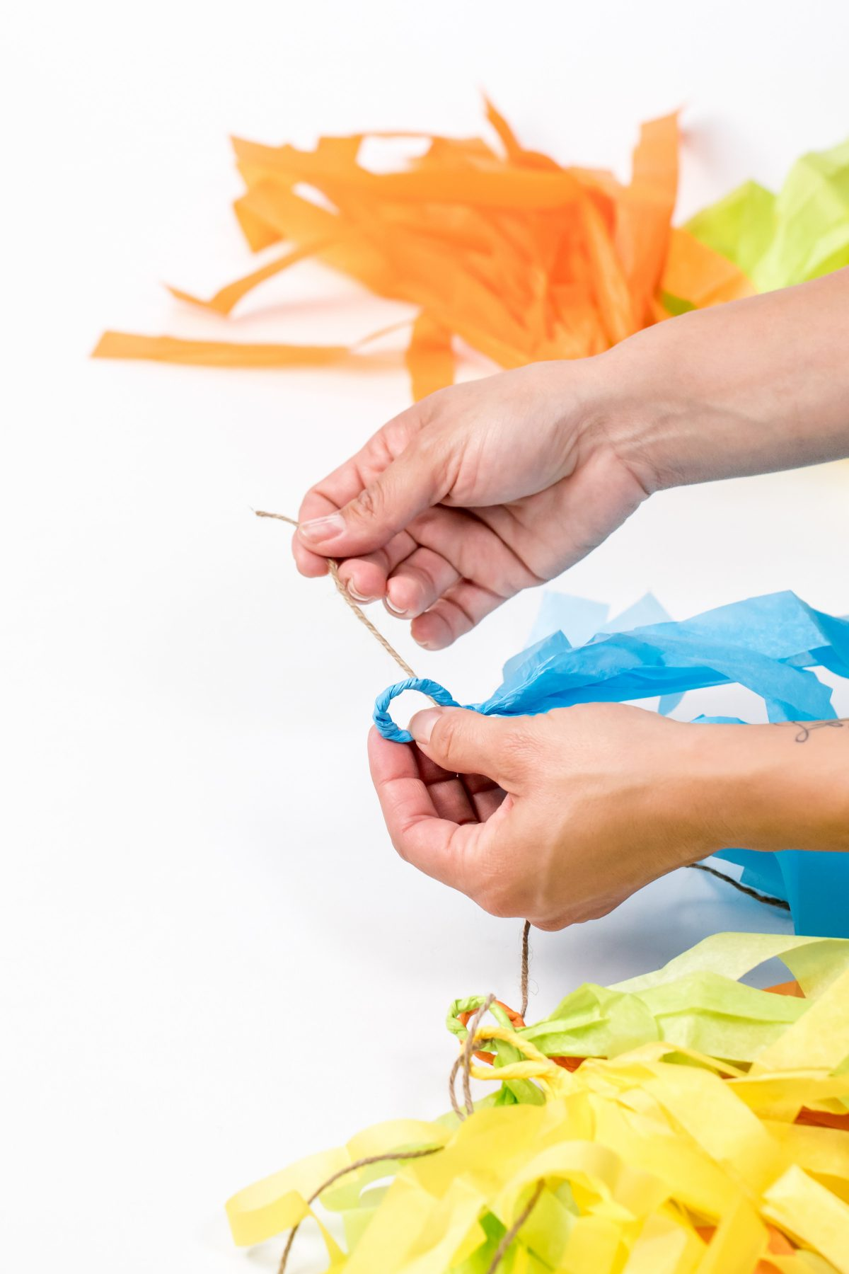5D4B3542 - Father s Day Banner - adding hemp string through the blue tissue paper loop