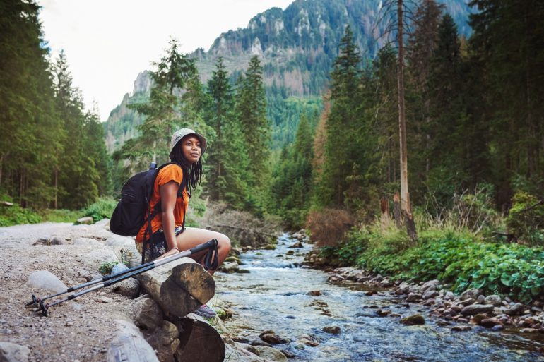 Ways to practice self-care in the New Year woman hiking
