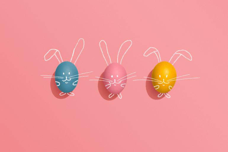 Easter egg rabbits on pink background