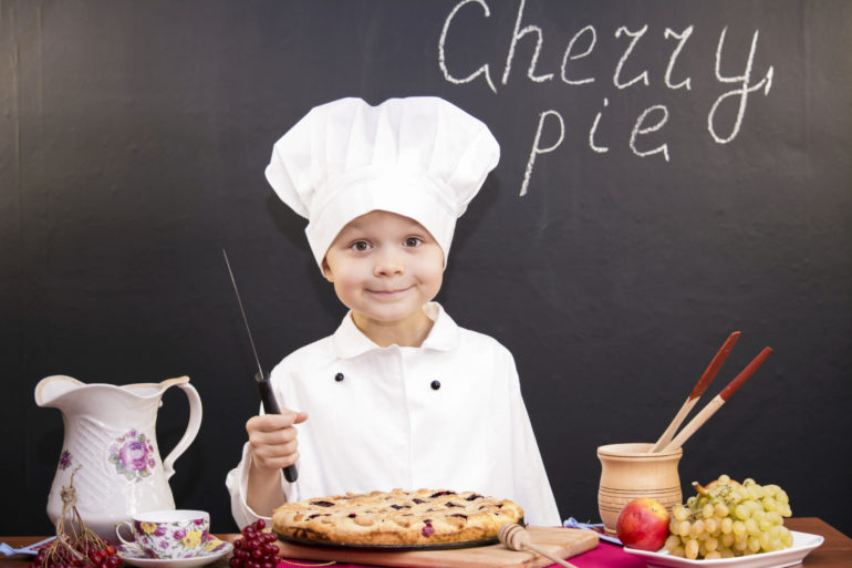 boy chef cooked cherry pie