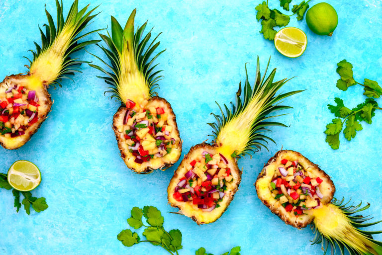 Pineapple salsa served in a pineapple shells