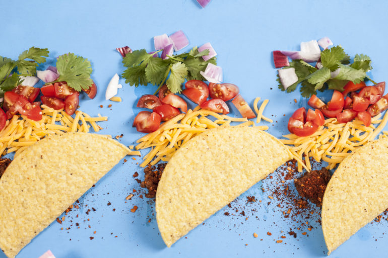 Mexican food crunchy beef tacos, ingredients in a row, knolling.
