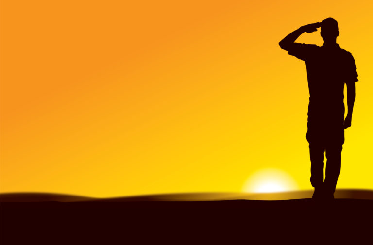 US Army Soldier Saluting at Sun Rise or Sun Set