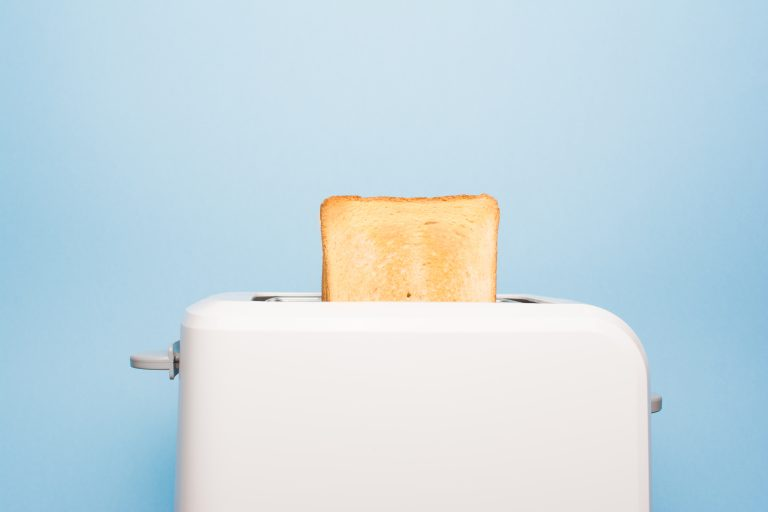 Healthy fashion food of breakfast. Toast in a toaster on a blue background.