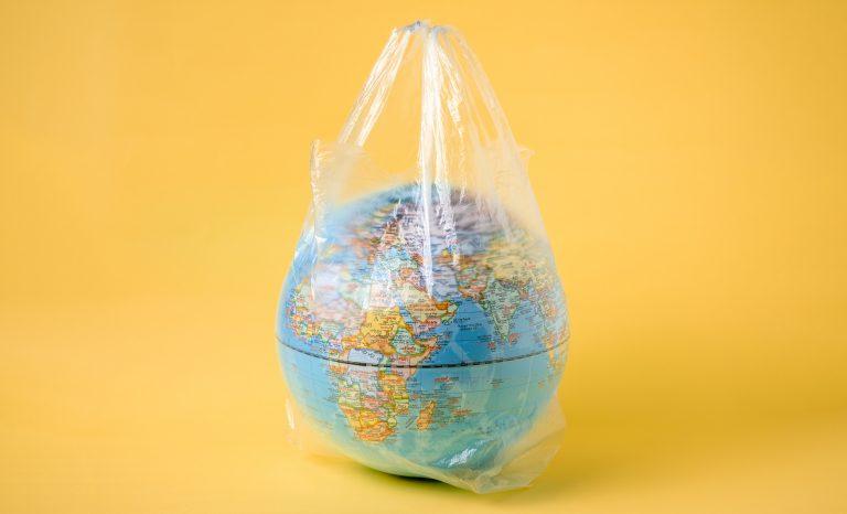 globe model in plastic bag, save the world environment